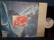 Dire Straits	On every street.		Ладъ	1991г. NM   LP